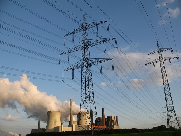 View of a coal-fired power station and electricity pylons